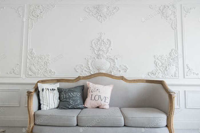 Beautiful Provance Living Room With Sofa over luxury wall decorated with stucco mouldings