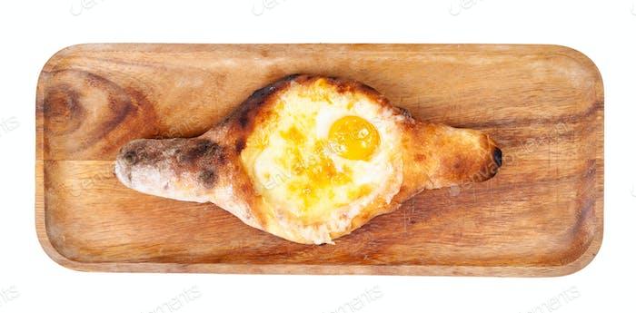 Adjarian khachapuri with egg yolk on tray isolated