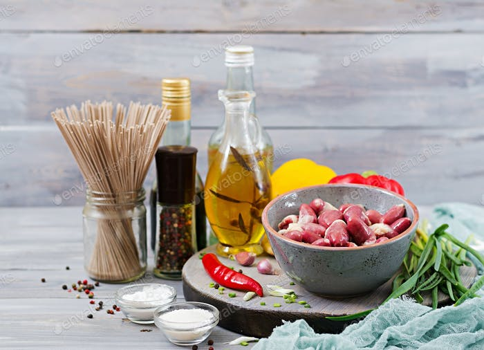 Raw chicken hearts. Ingredients for cooking stir-fry and buckwheat noodles. Chinese cuisine