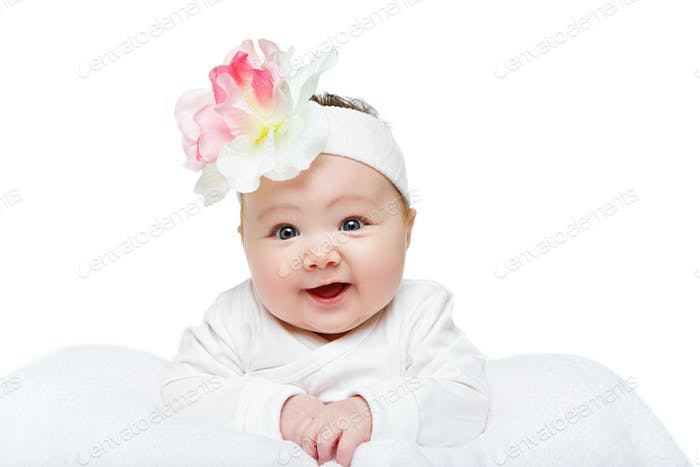 happy beautiful baby girl with flower headband