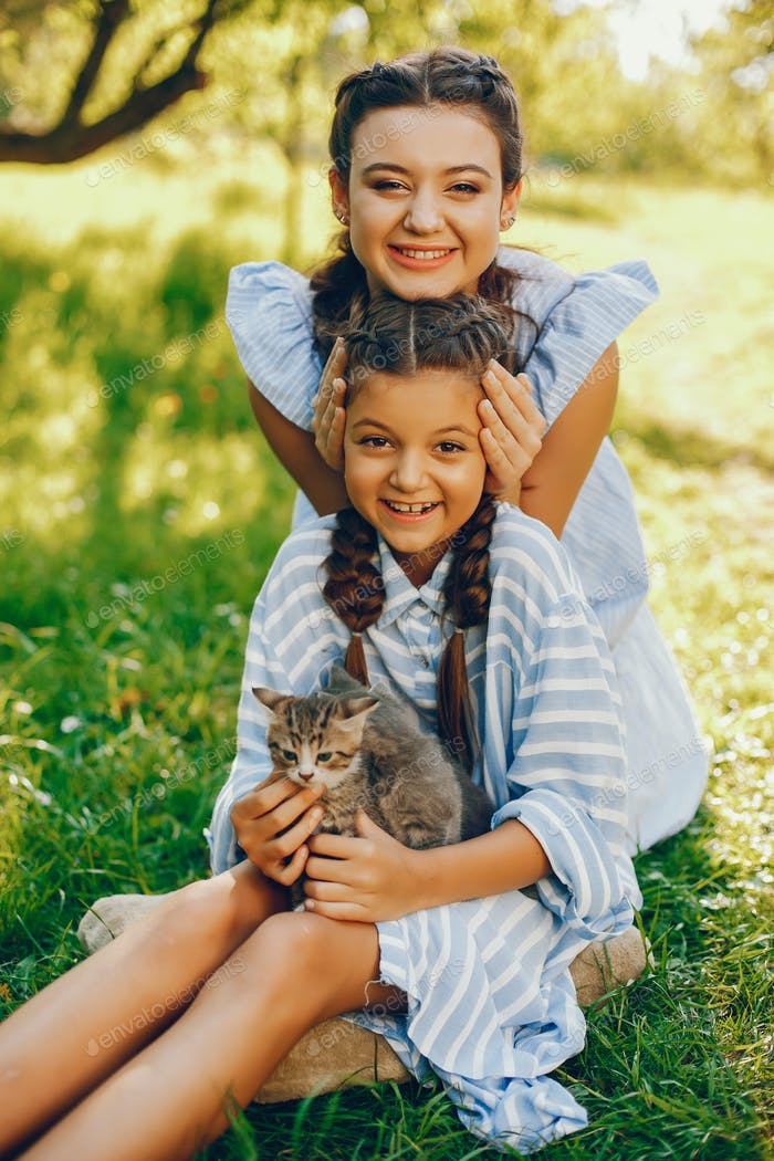 two beautiful girls with cats