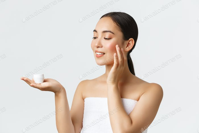 Beauty, personal care, spa salon and skincare concept. Close-up of beautiful young asian woman