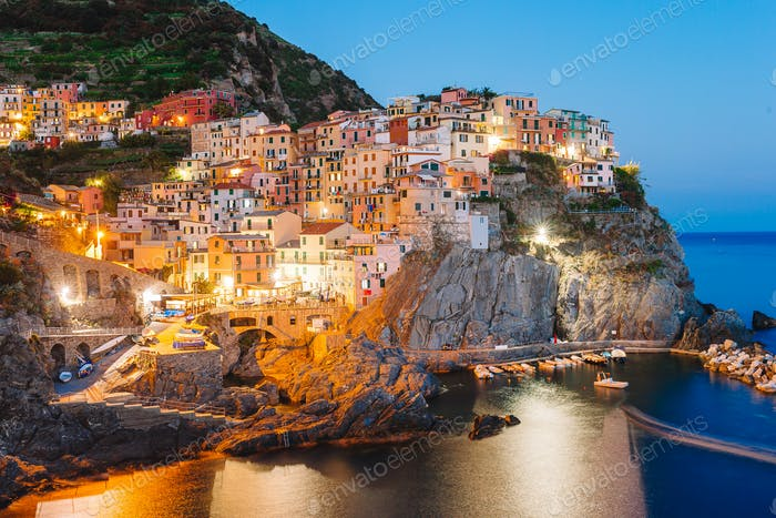 Stunning view of the beautiful and cozy village of Manarola in the Cinque Terre Reserve at sunset