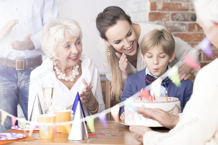 Family watching birthday boy