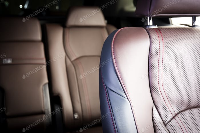 Red perforated leather details, luxury car interior