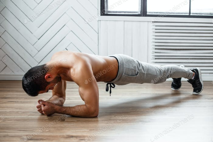 A man doing stomach workout.