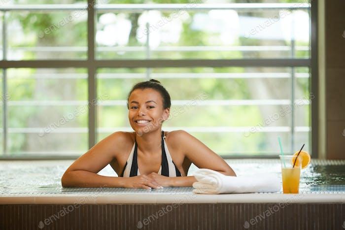 Beautiful Woman Posing in Hotel Pool