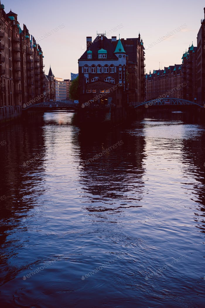 Silhouette of water castle in old Speicherstadt or Warehouse district in evening sun light, Hamburg