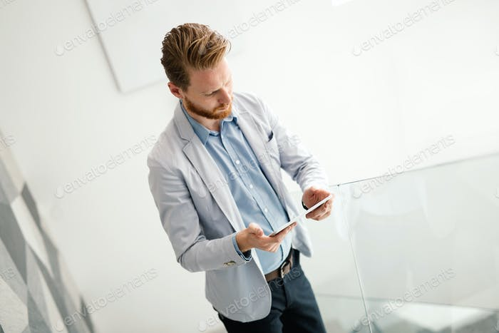 Business people using devices