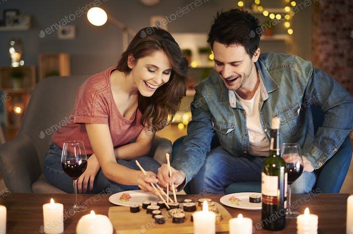 Boyfriend and girlfriend trying Asian food