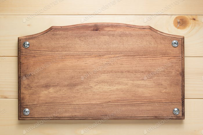 nameplate or wall sign at  wooden background