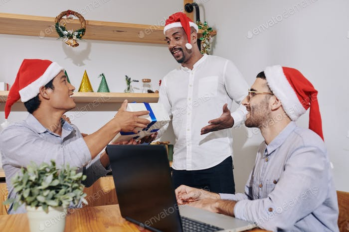 Coworkers exchanging presents