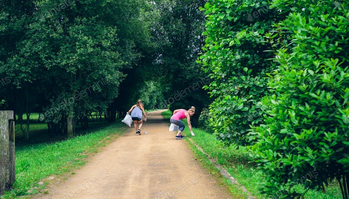 Two girls on back doing plogging
