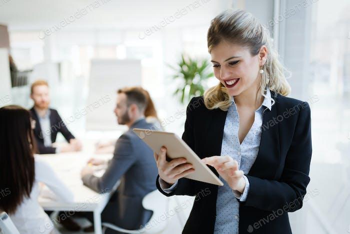 Elegant smart businesswoman in company office