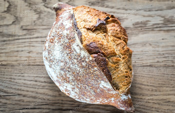 Wholegrain bread on the wooden background