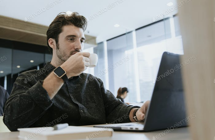 Casual man working in a cafe