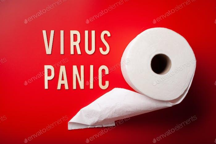 virus panic word text wooden letter toilet paper on red background coronavirus covid-19