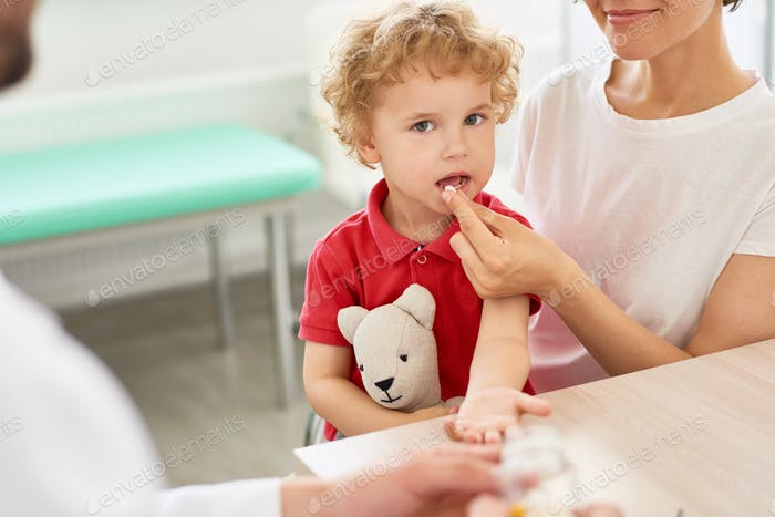 Little Boy taking Pills