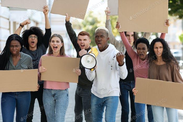 African american leader leading international group of protestors