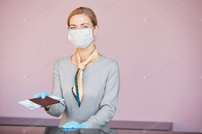 Blonde Woman Wearing Mask at Check In Desk in Airport