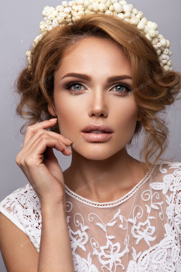 Make up. Glamour portrait of beautiful woman model with fresh makeup and romantic wavy hairstyle
