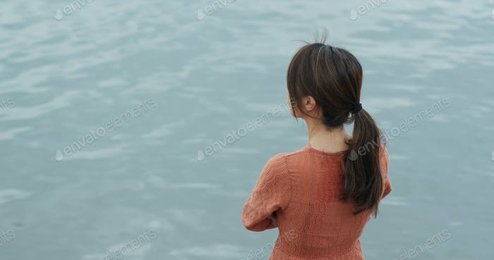 Woman look around in the sea