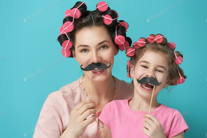 Mother and her daughter with a paper accessories