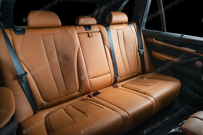 Red leather car seats back passengers seats modern comfortable cockpit