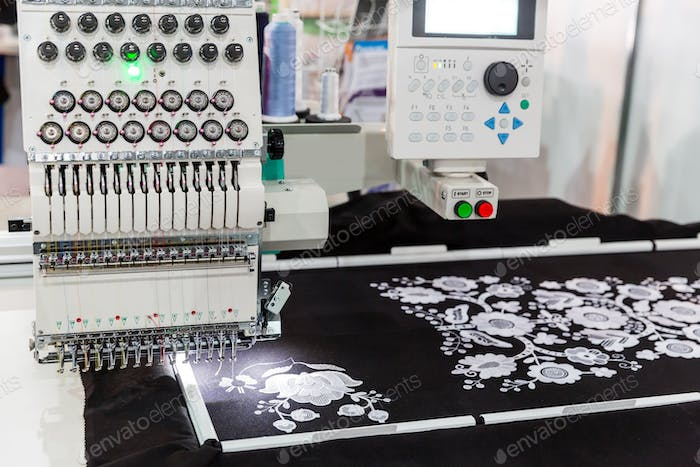 Sewing machine in work, textile fabric, nobody