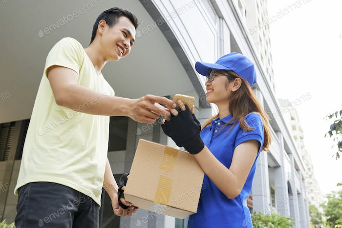 Happy man receiving package