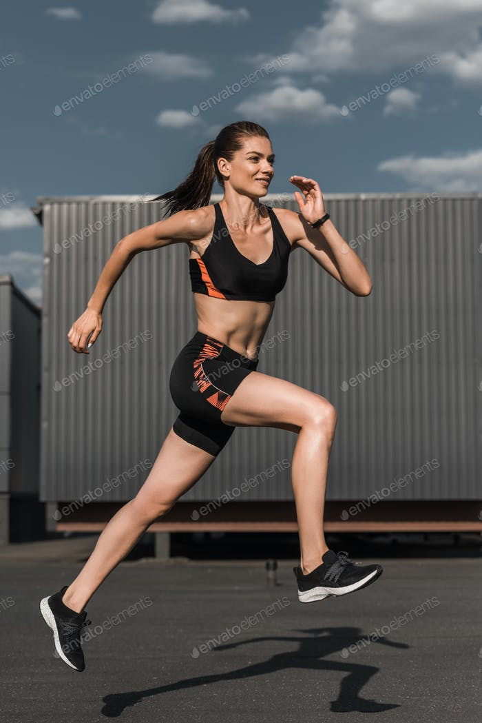 young athletic runner training in city