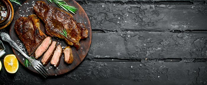 Grilled beef steaks on a cutting Board.
