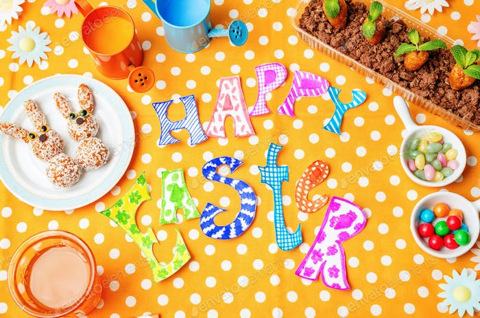 Happy Easter words with sweets and juice for kids