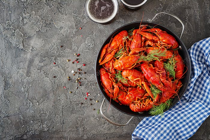 Crayfish. Red boiled crawfishes on table in rustic style, closeup.