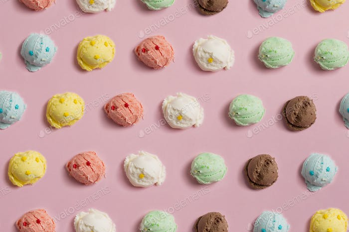 Seamless pattern of balls of natural colorful ice cream on a pink background