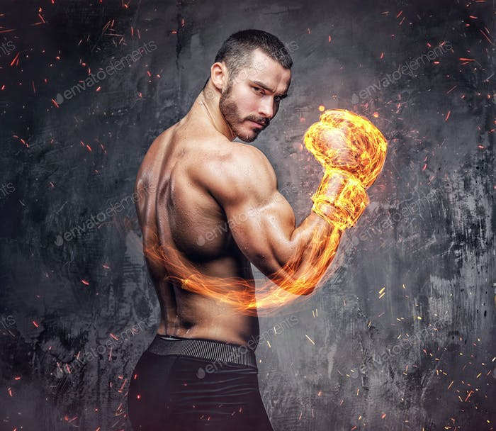 Shirtless aggressive fighter with burning boxer gloves.