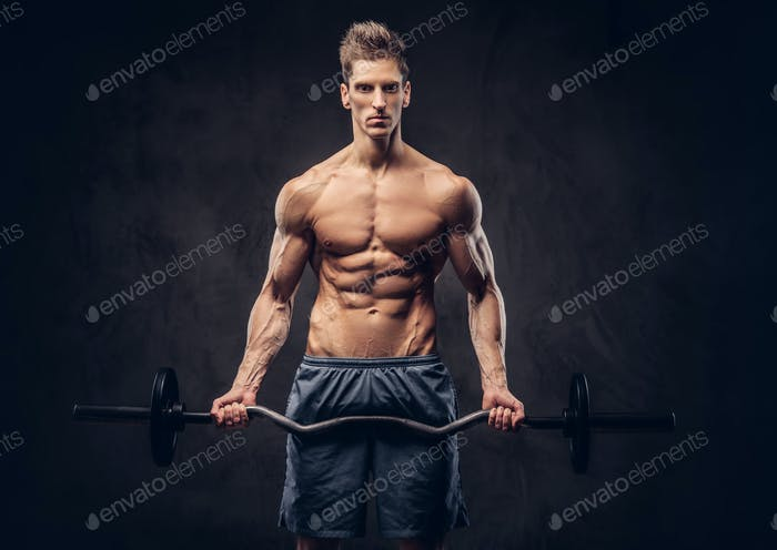 Shirtless man with stylish hair and muscular ectomorph doing the exercises with the barbell