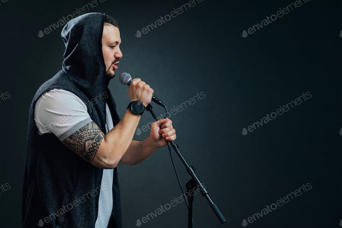 Male vocalist or singer wearing a hoodie