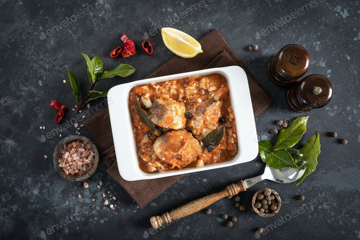 Hake fish, cooked in tomato sauce with vegetables and spices