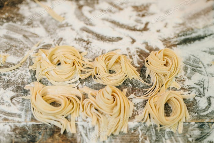 Uncooked homemade fettuccine closeup, nobody