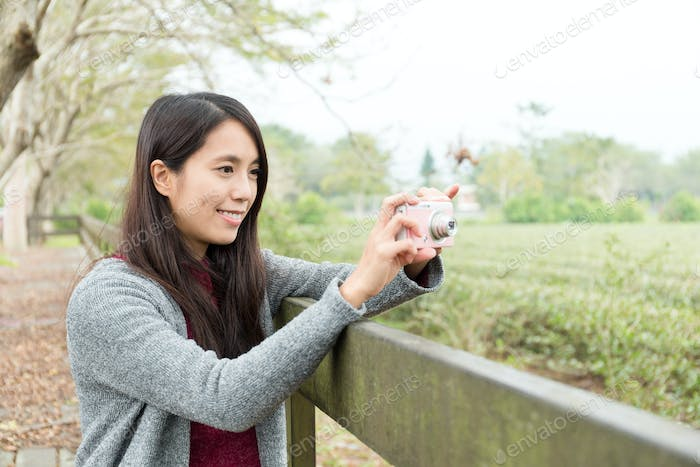 Asian Woman taking picture at outdoor