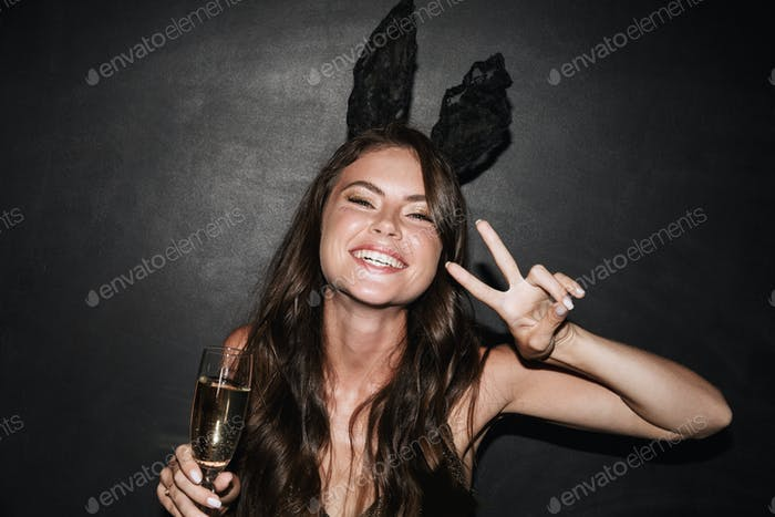 Beautiful lovely young girl wearing fancy dress celebrating