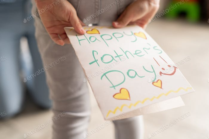 Creative fathers day card with hearts