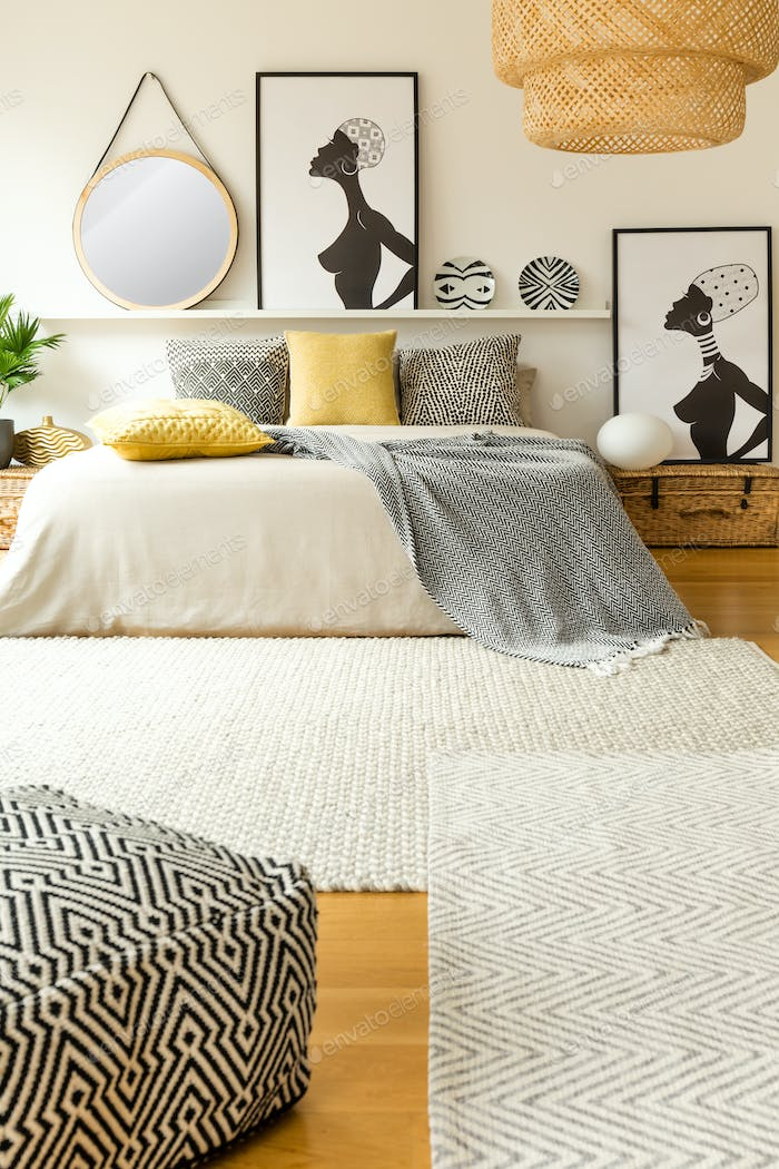 Warm bedroom interior with posters