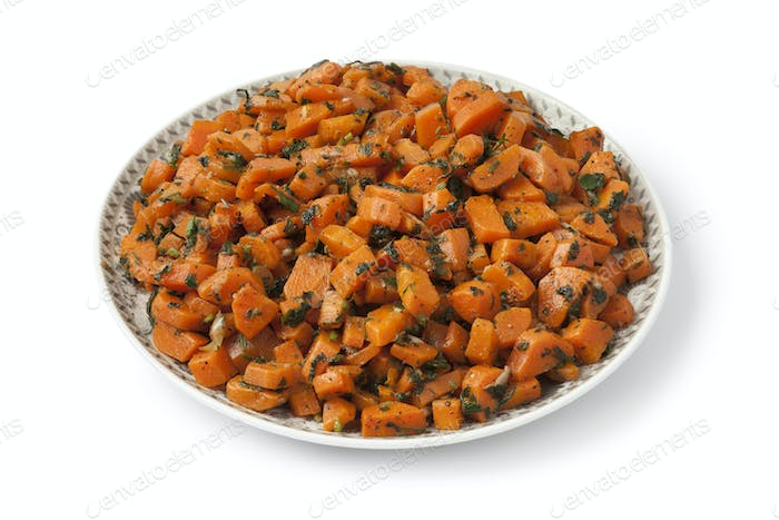Moroccan dish with carrot salad and herbs