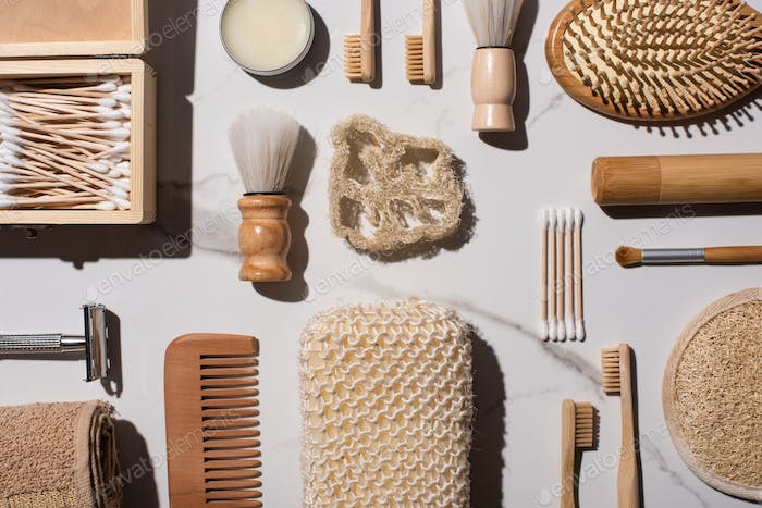 Top view of different hygiene and beauty items on white background, zero waste concept