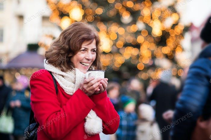 Senior woman on an outdoor Christmas market.