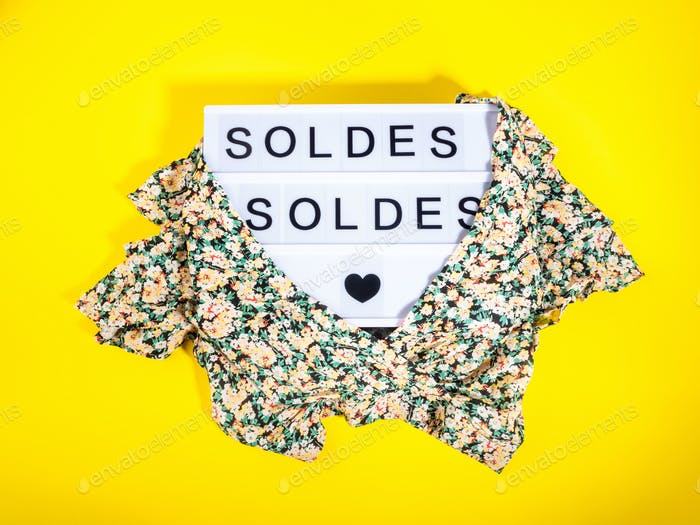 Fashion sale concept with lightbox Spanish text and floral shirt on yellow