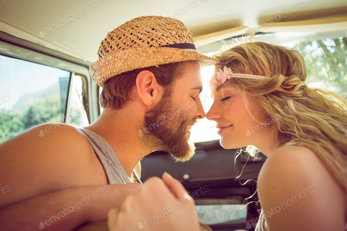 Hipster couple on road trip on a summers day