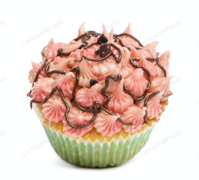 Cupcake with pink icing against white background in front of white background
